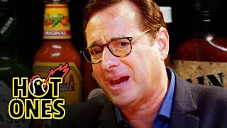 Download Bob Saget Hiccups Uncontrollably While Eating Spicy Wings | Hot Ones Video