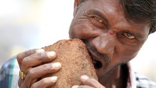 Download Man Addicted To Eating Bricks, Mud and Gravel Video