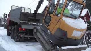 Download Volvo mini excavator climbing truck. Video