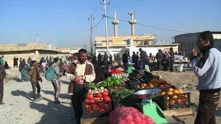 Download On edge of Mosul, shoppers savour market life again Video