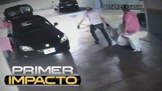 Download En video: momento en que asesinos tratan de llevarse el cuerpo de su víctima envuelto en una sábana Video