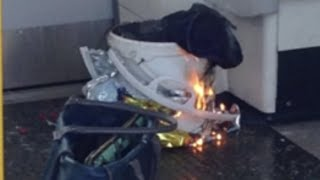 Download Burning device filmed on tube carriage at Parsons Green station Video