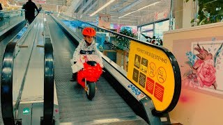 Download Funny Den ride on red sportbike to the kids store buy new toy Video
