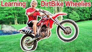 Download TEACHING ME TO DIRTBIKE WHEELIE!! Video