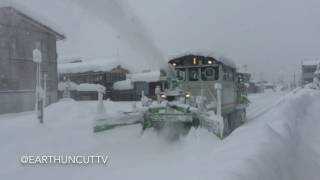 Download Snow Clearing Train Churns Through Drifts In Japan Video