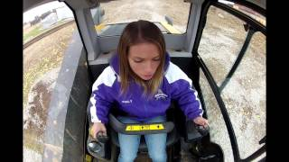 Download Beautiful Girl learning how to operate JCB 320T ECO Skid Loader! Video
