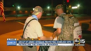 Download Group of armed veterans protecting homeless vets Video