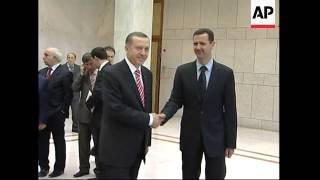 Download WRAP Erdogan meets FM at airport; President Assad; photo op Video