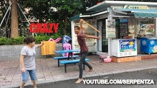 Download Man beats random people with pole Video