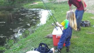 Download little girl catches big fish Video