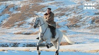 Download N. Korean leader Kim Jong-un rides horse to Mount Paekdu, slams U.S. sanctions Video