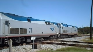 Download Amtrak Train Almost Slices Through CSX Tropicana Juice Train Video