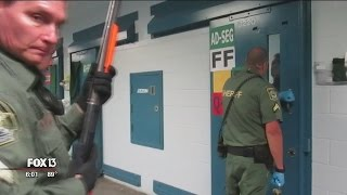 Download Video shows corrections officer shooting inmate through cell door Video