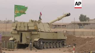 Download Iraqi heavy artillery targets militant positions Video