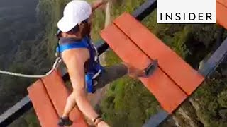 Download Walk Across A 500-Foot-High Bridge In China Video