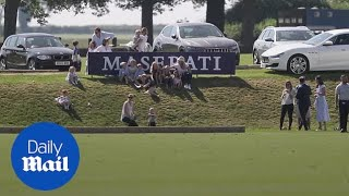 Download Prince George gets pushed down the hill by his cousin at polo match Video