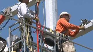 Download Transmission line crews work near Culbertson Generation Station Video