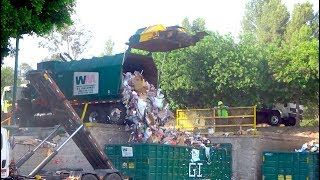 Download Waste Management Recycling Trucks Unloading Video