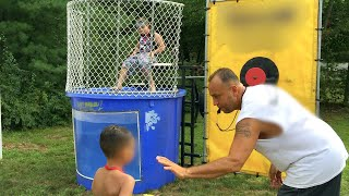 Download Screaming Ecstatic Kids Dunk in the Tank Boys Versus Girls Challenge Who is better? Video