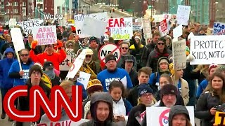 Download Massive crowds rally coast to coast to demand gun control Video