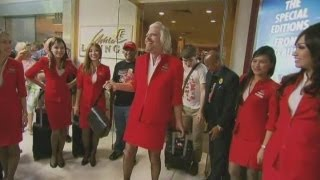 Download Sir Richard Branson dresses as an air hostess after losing bet with AirAsia chief Video