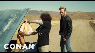 Download Conan O'Brien Drives an Explosives-Packed Car Off A Cliff! Video