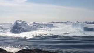 Download Ilulissat Icefjord - Large iceberg breaking over Video
