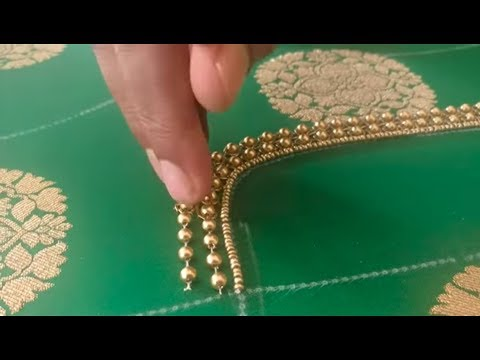 Highlighting the brocade work using beads on a designer blouse