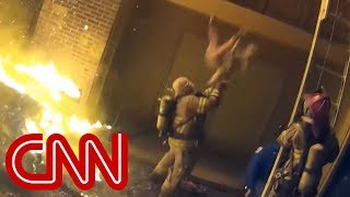 Download Firefighter catches child tossed from burning building Video