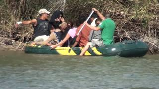 Download Immigrants crossing the Rio Grande river Video