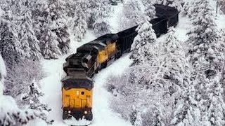 Download Awesome Powerful Train plow through snow railway tracks Video