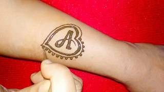 Download 'A' letter henna tattoo design with heart shape Video