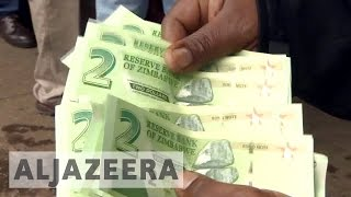 Download Zimbabwe hopes new currency will ease cash crunch Video