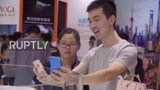 Download China: Vivo beats Apple, unveils first-ever phone with under-screen fingerprint technology Video