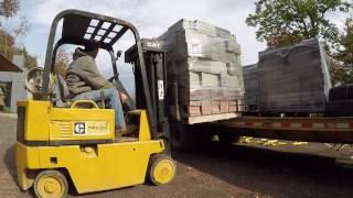Download Forklift unloading cinder blocks Video