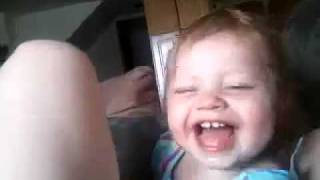 Download Baby thinks licking my leg is funny Video
