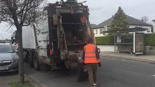 Download Greyhound collecting black bins Video