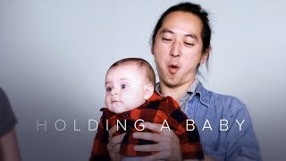 Download Holding a Baby for the First Time in Slow Motion | First Takes | Cut Video