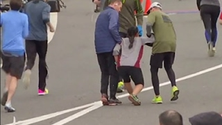 Download Raw: Exhausted Runner Helped to Finish Line Video