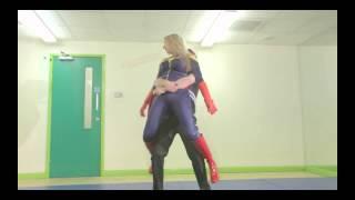 Download Superheroine reverse bear hug slide show Video