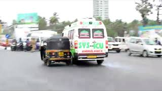 Download Ambulance rams bike riders at traffic signal Video