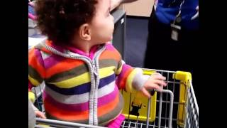 Download Baby girl entertained by Best Buy associate Video
