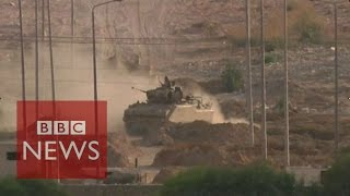 Download Egypt battles ISIS in Sinai - BBC News Video