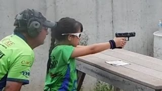 Download This 10-year-old knows how to use a gun Video