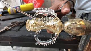 Download Glass artist Manolo Aguilera creates a traditional Venetian goblet with gold leaf Video
