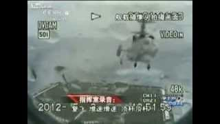 Download Badass Chinese helicopter pilot lands on warship during storm | That's Magazines Video