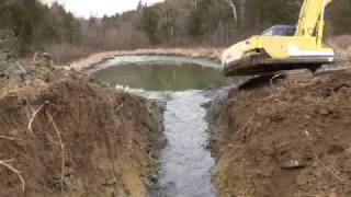 Download Cleaning out an old pond Video