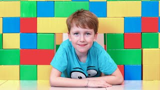 Download Eli building Toy Brick Playhouse for interactive puppy Video