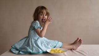Download Girl With Crisps Licking Her Hand Clean | Stock Footage Video