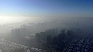 Download Choking smog begins to clear in China Video